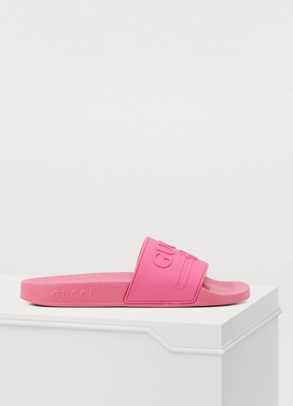 225561b21bf Gucci. Gucci Pursuit Gucci print slippers